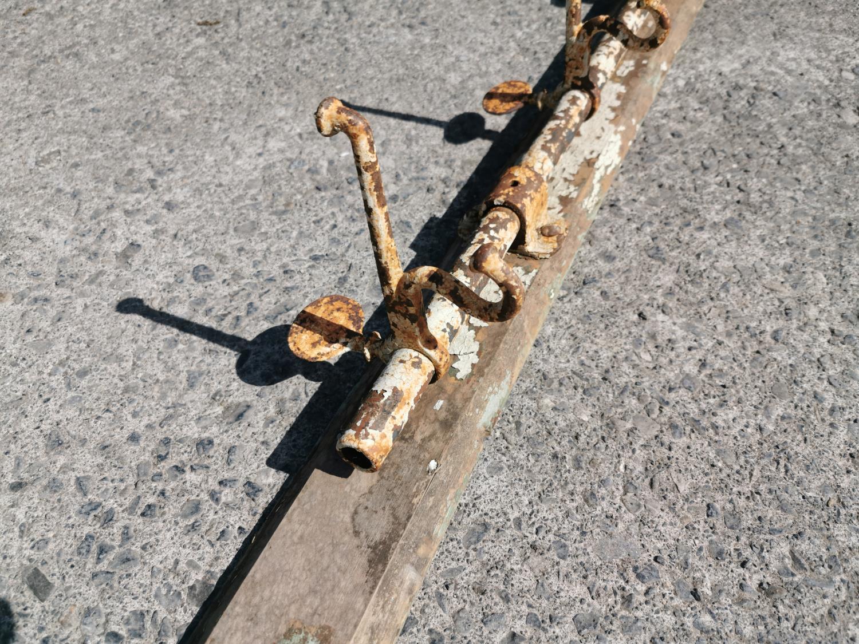 Early 20th C. iron coat hooks. - Image 3 of 3