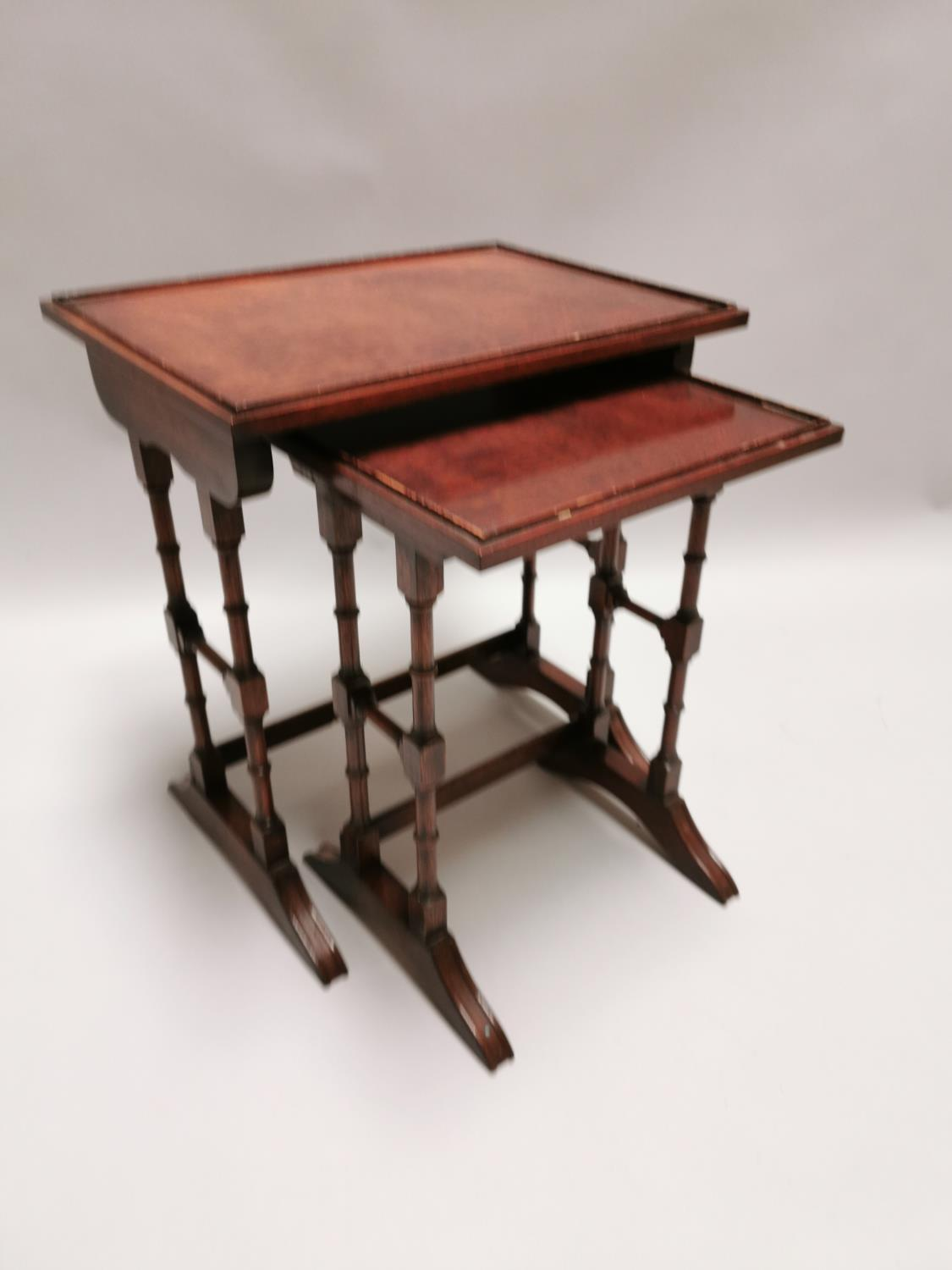 Nest of two mahogany tables