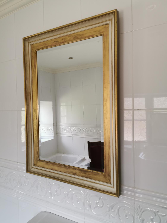 Decorative gilt wall mirror