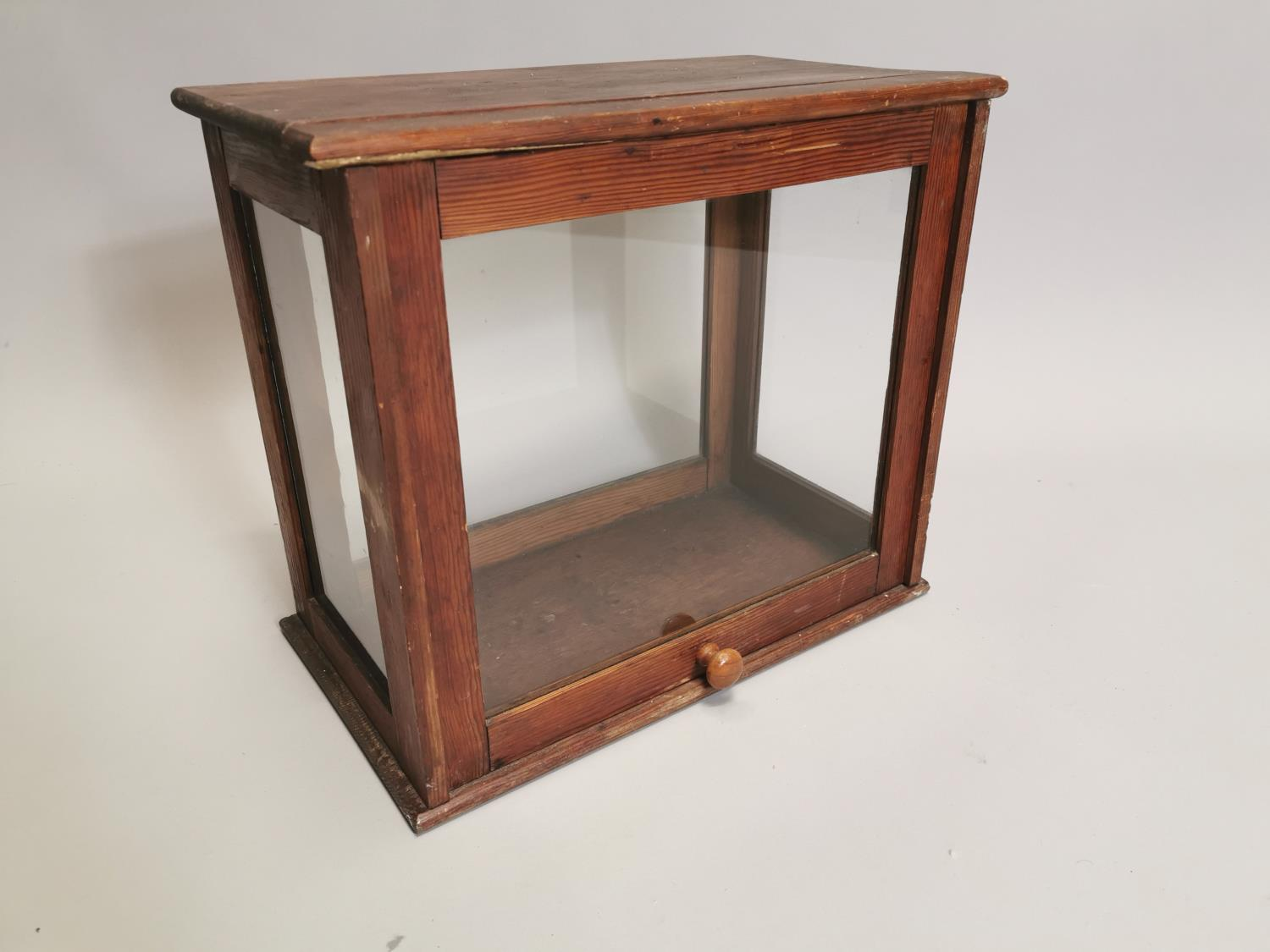 Early 20th. C. glazed pine display cabinet
