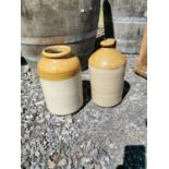 Two stoneware jars.