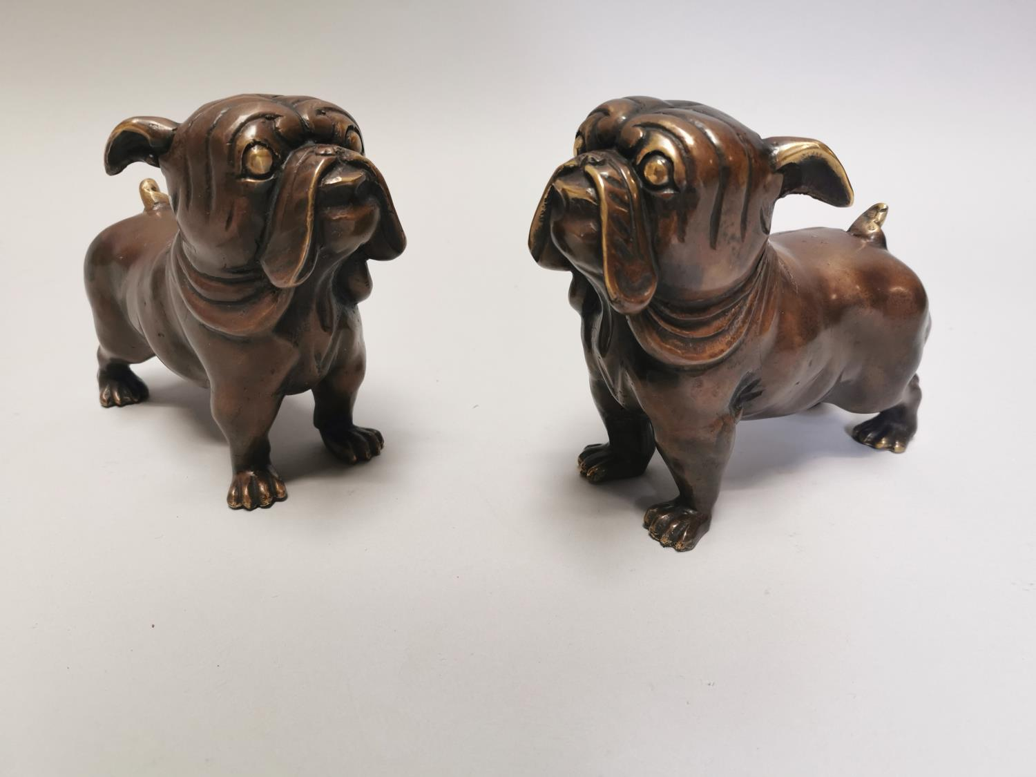 Pair of bronze models of pug dogs