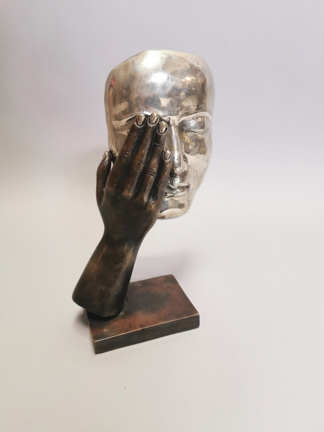 Bronze model of a hand and mask