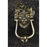 Brass door knocker.