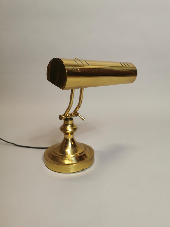 Brass desk lamp.