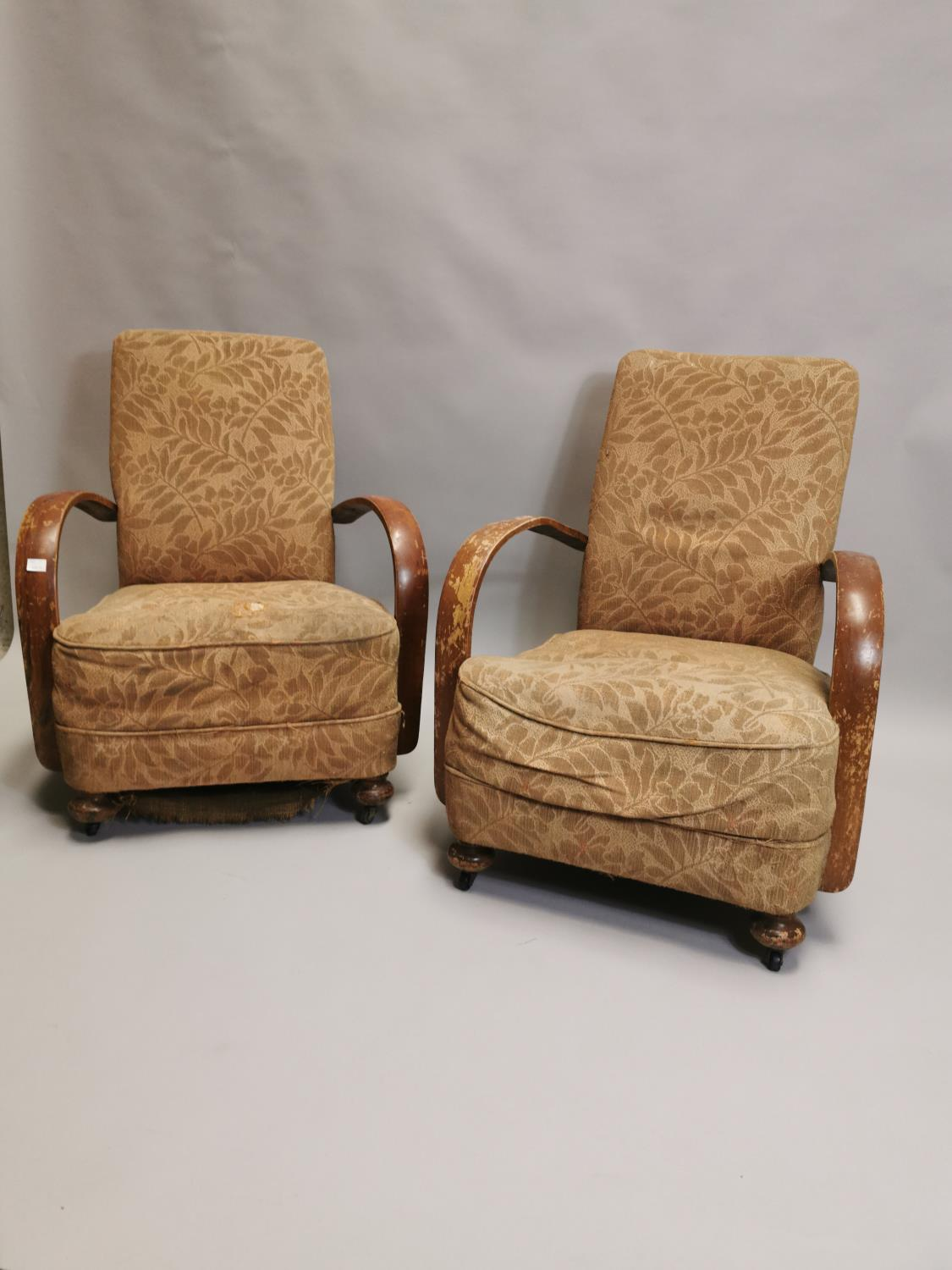 Pair of 1940's upholstered open armchairs