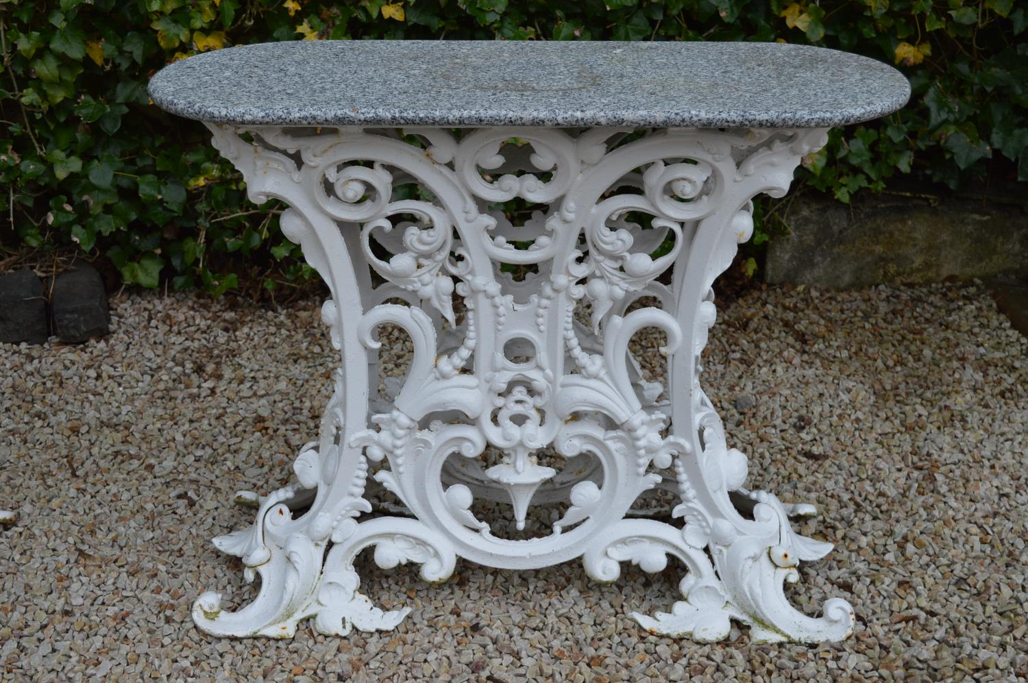 Cast iron garden table marble top in the Coalbrookdale style. 90W 75H 36D