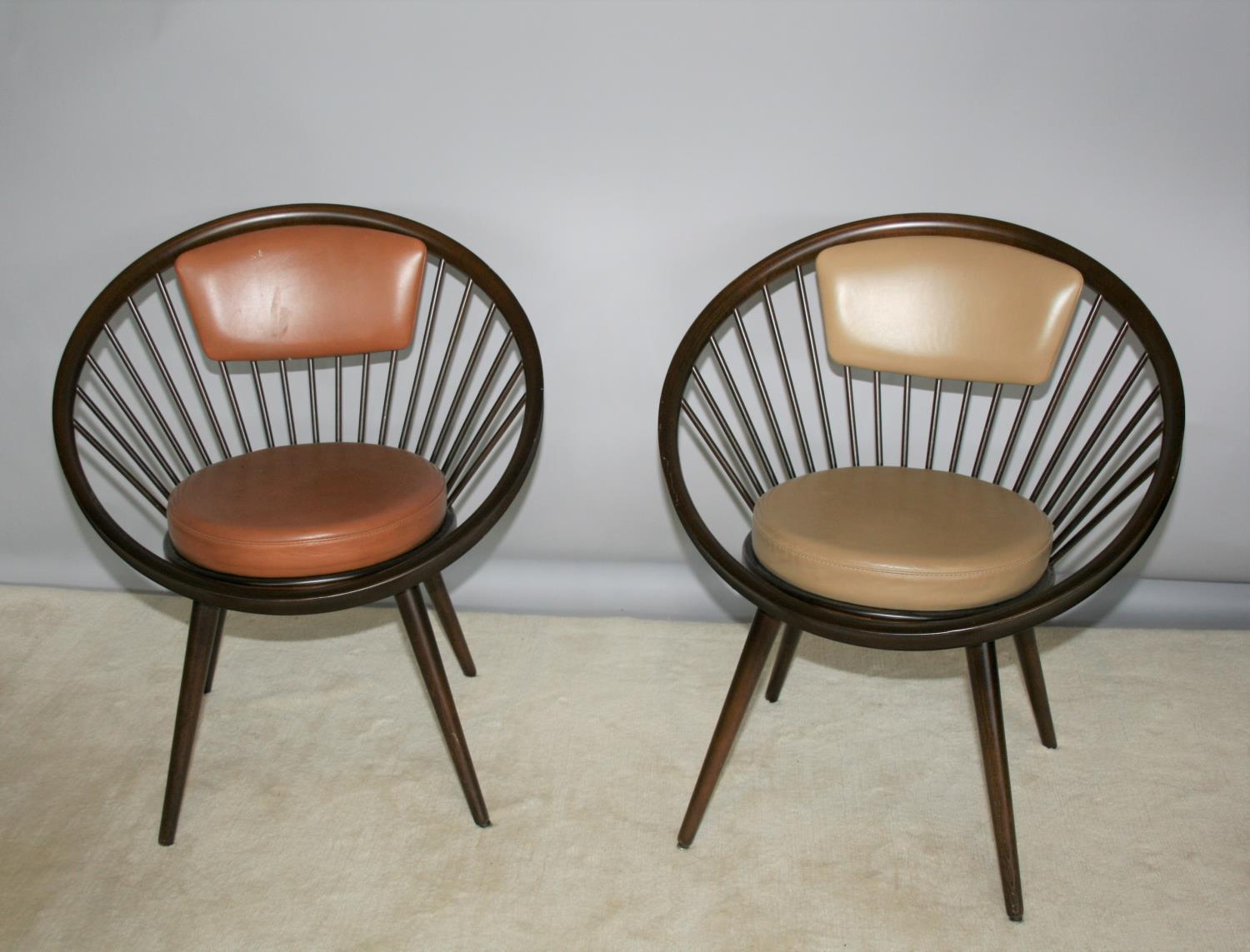 Near pair of stylish circular framed chairs with leather upholstery 28 W x 31 H x 22 D