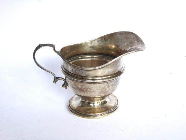 Plain U shape silver milk jug with reeded girdle design on pedestal base. Birmingham 1914 by