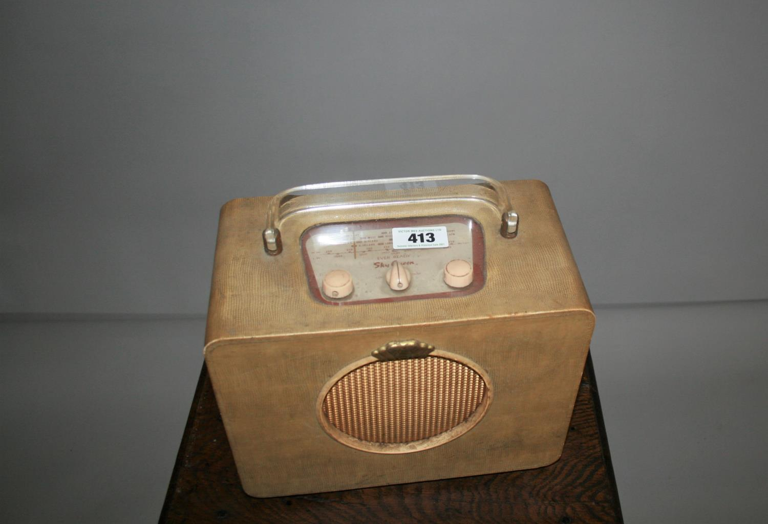 Cool vintage Ever Ready radio with perplex carrying handle. 30W x 30H x 18D