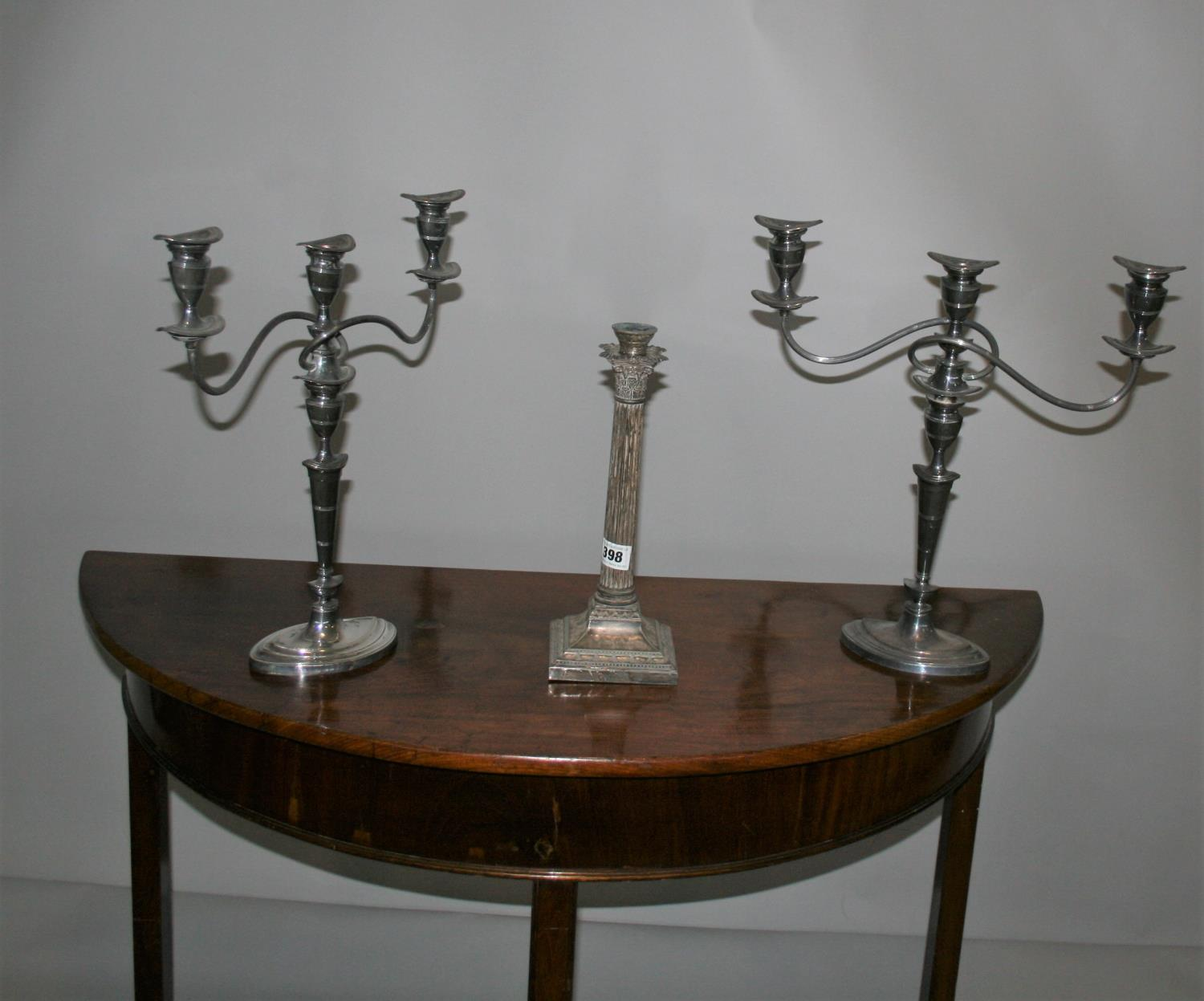 West & Son, Dublin, silver plated lamp base and a pair of candle sticks.