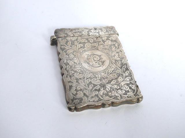 Victorian scroll pattern silver card case. Birmingham 1897 by William Neale