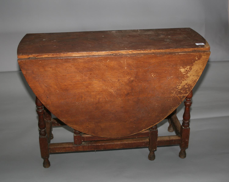 19th Century oak double drop leaf table. 107W x 76H x 43D