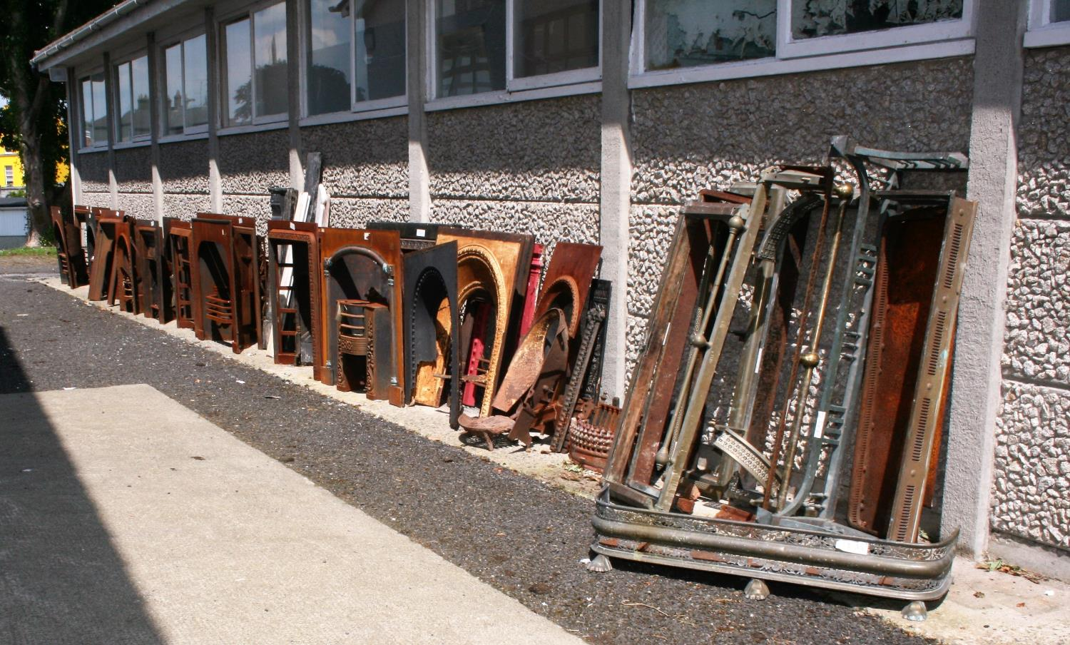 Large collection of antique cast iron fire insets, fire grates, fenders etc.