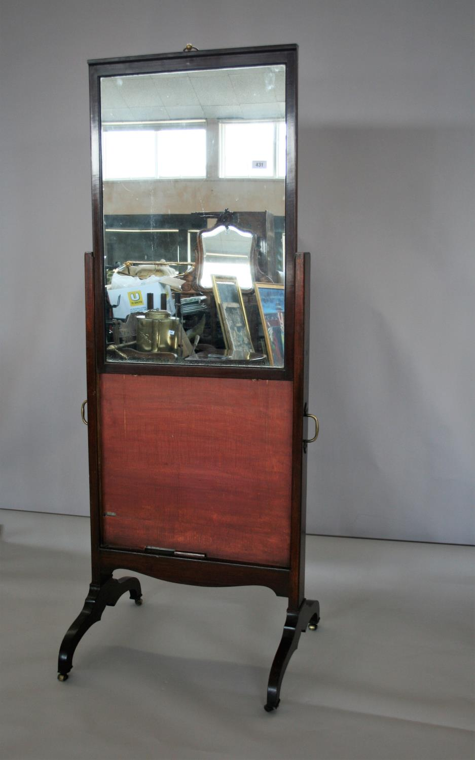 Georgian mahogany robing mirror with rise and fall action with brass carrying handle. Jackson of