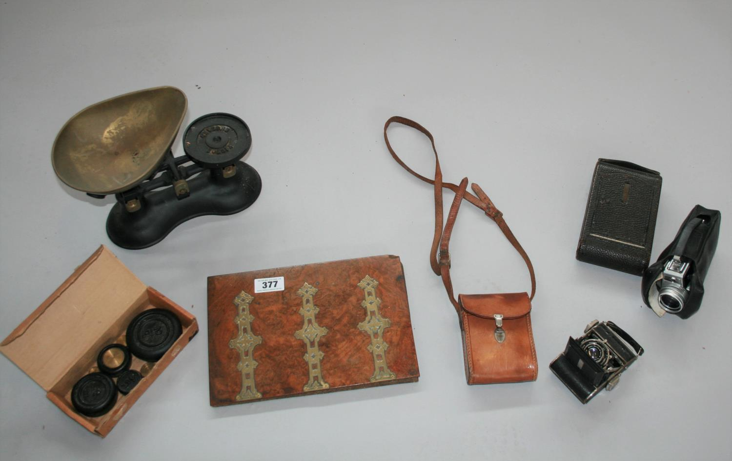 Antique walnut and brass stationary holder, vintage cameras, weighing scales and weights.