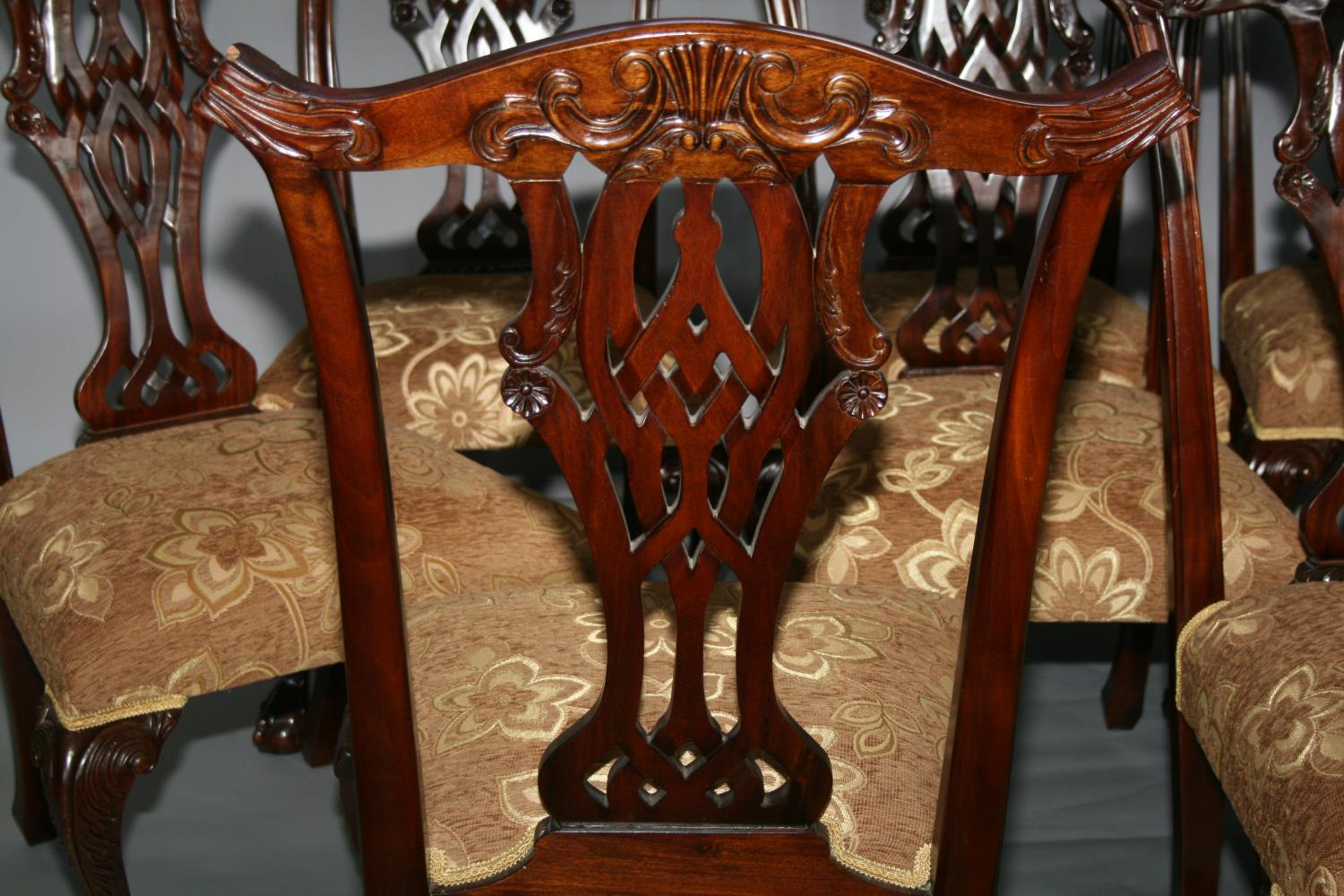 Set of eight Chippendale style dining chairs with floral gold upholstery. 59W x 103H - Image 2 of 3