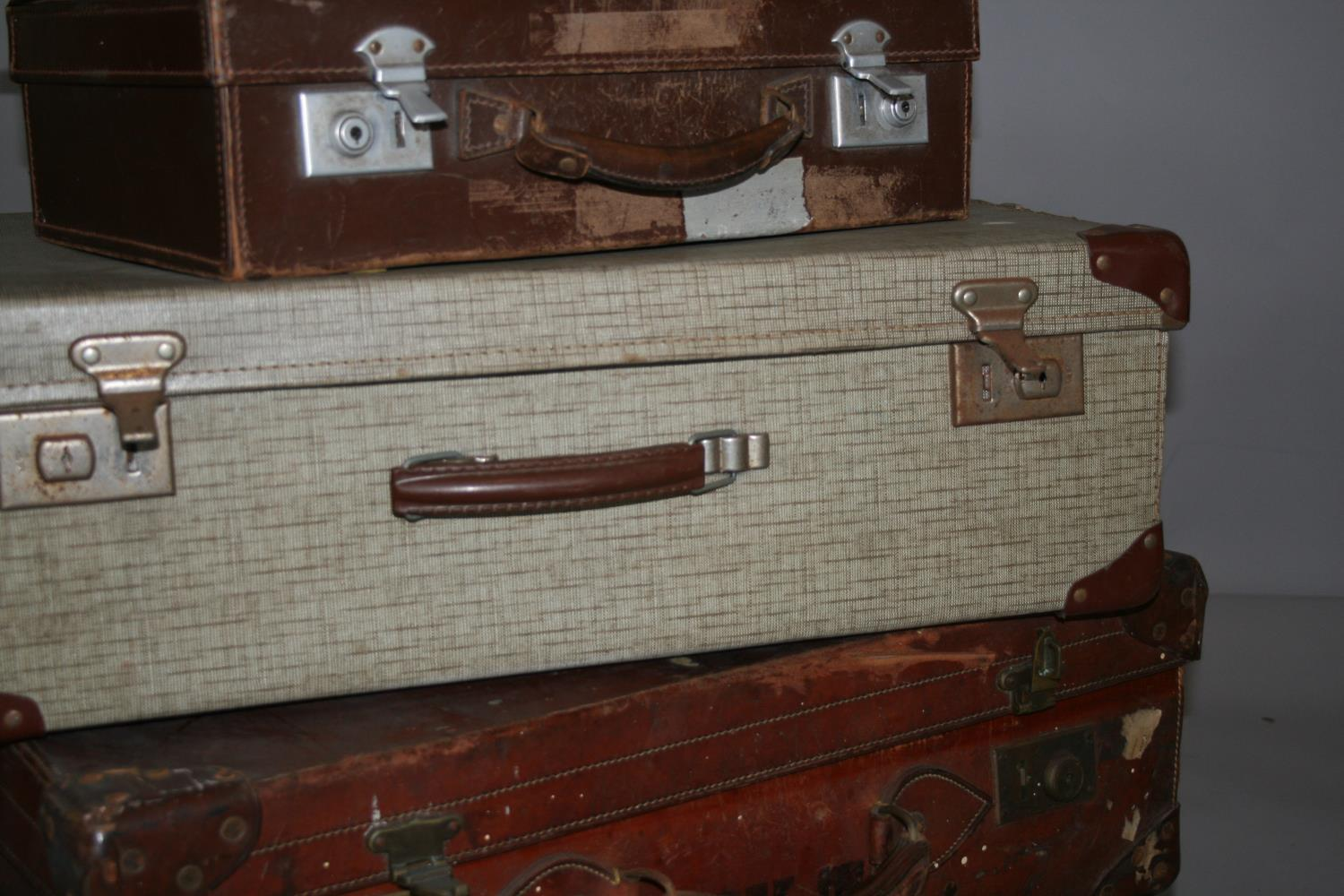 Four vintage leather suitcases, with compass, blade sharpener and wood plain. - Image 4 of 7