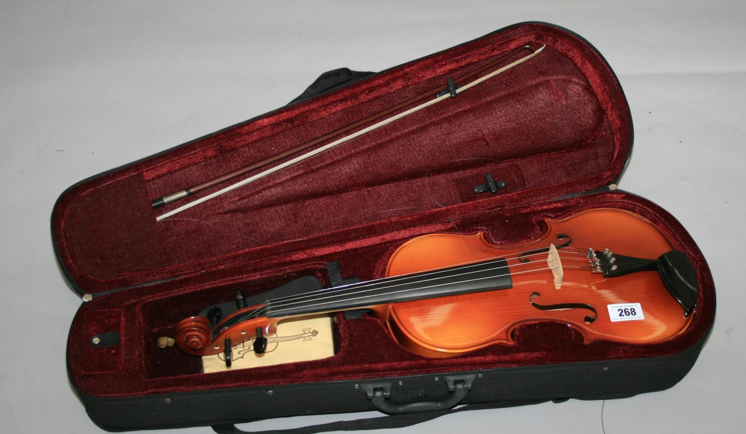 Quality cased violin Teller of Germany. 25W x 70 H.
