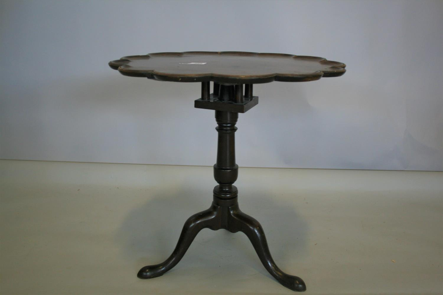 Georgian mahogany tripod table of high crust form with bird cage action. 70W x 70H