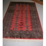 Persian design runner of rust coloured background. 210W x 130H