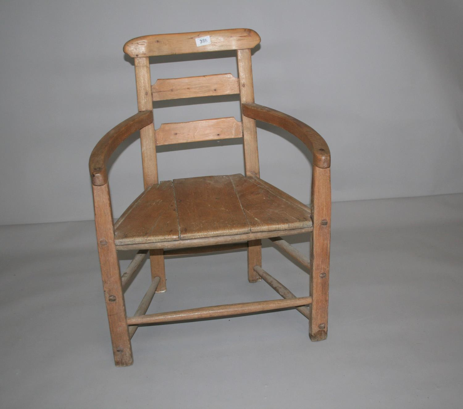 Quirky 19th Century pine wide arm chair. 56W x 90H x 55D