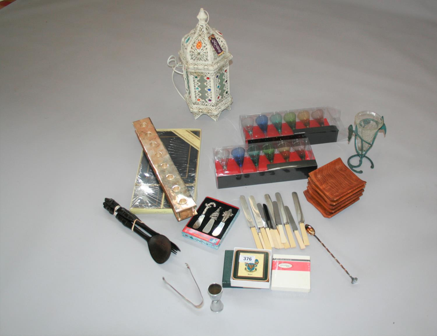 Collection of miscellaneous items including liquor glasses and table setting and electric lantern.