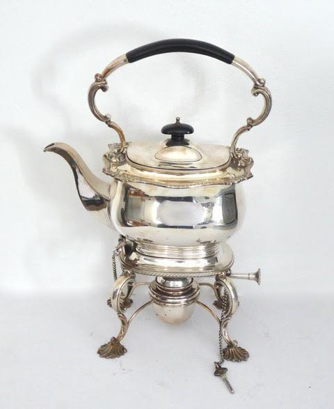 Plain rectangular silver plated kettle on stand with burner.