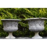 Pair of sandstone planters with figural decoration on circular bases 77W 69H
