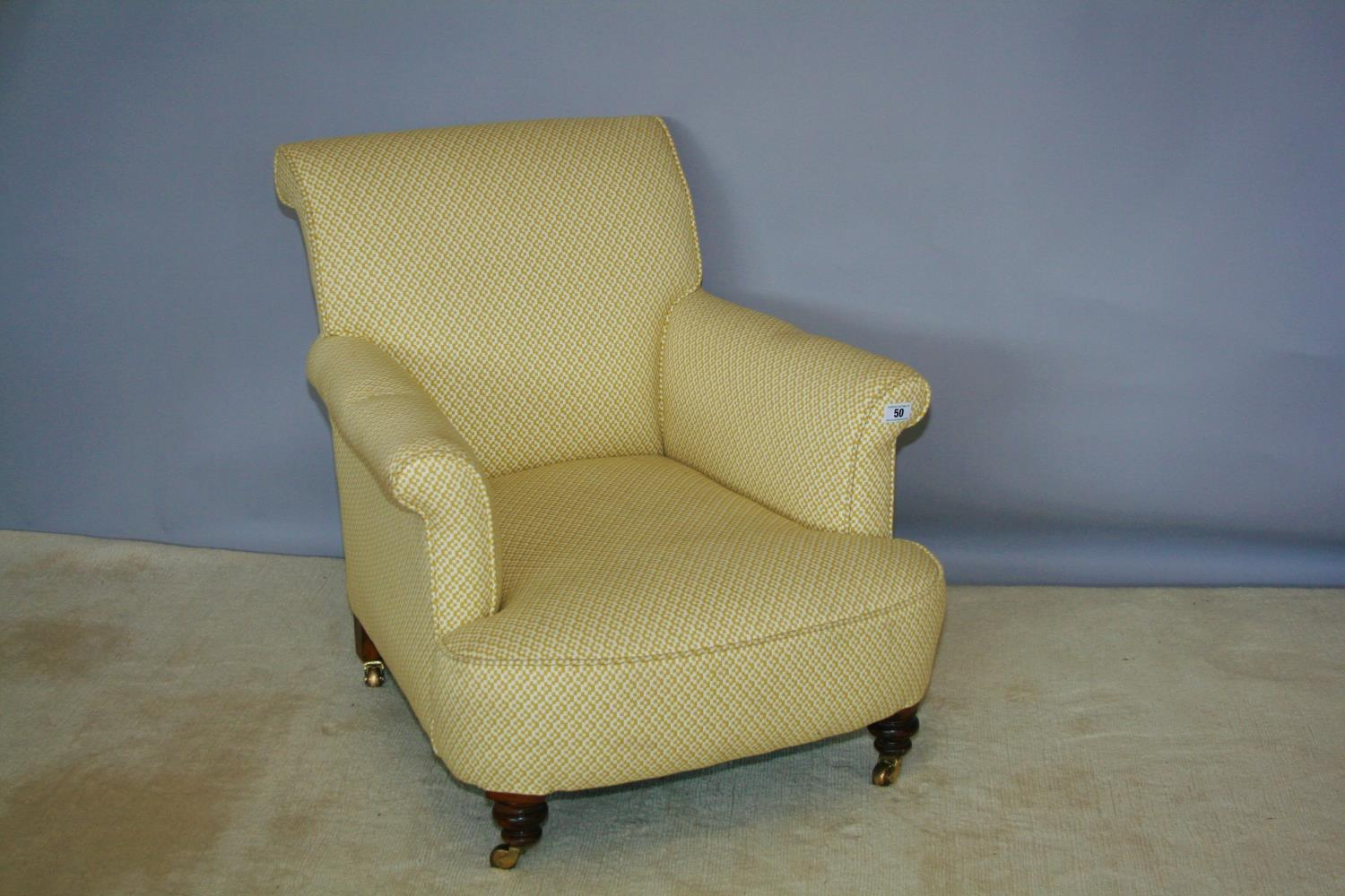 Edwardian upholstered occasional armchair on brass casters 75 W x 80 H x 90 D