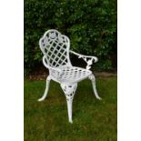 Set of four cast iron patio arm chairs 30W 48H