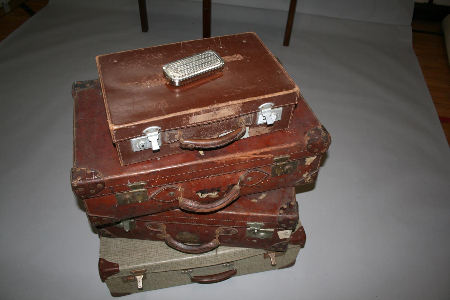 Four vintage leather suitcases, with compass, blade sharpener and wood plain. - Image 2 of 7