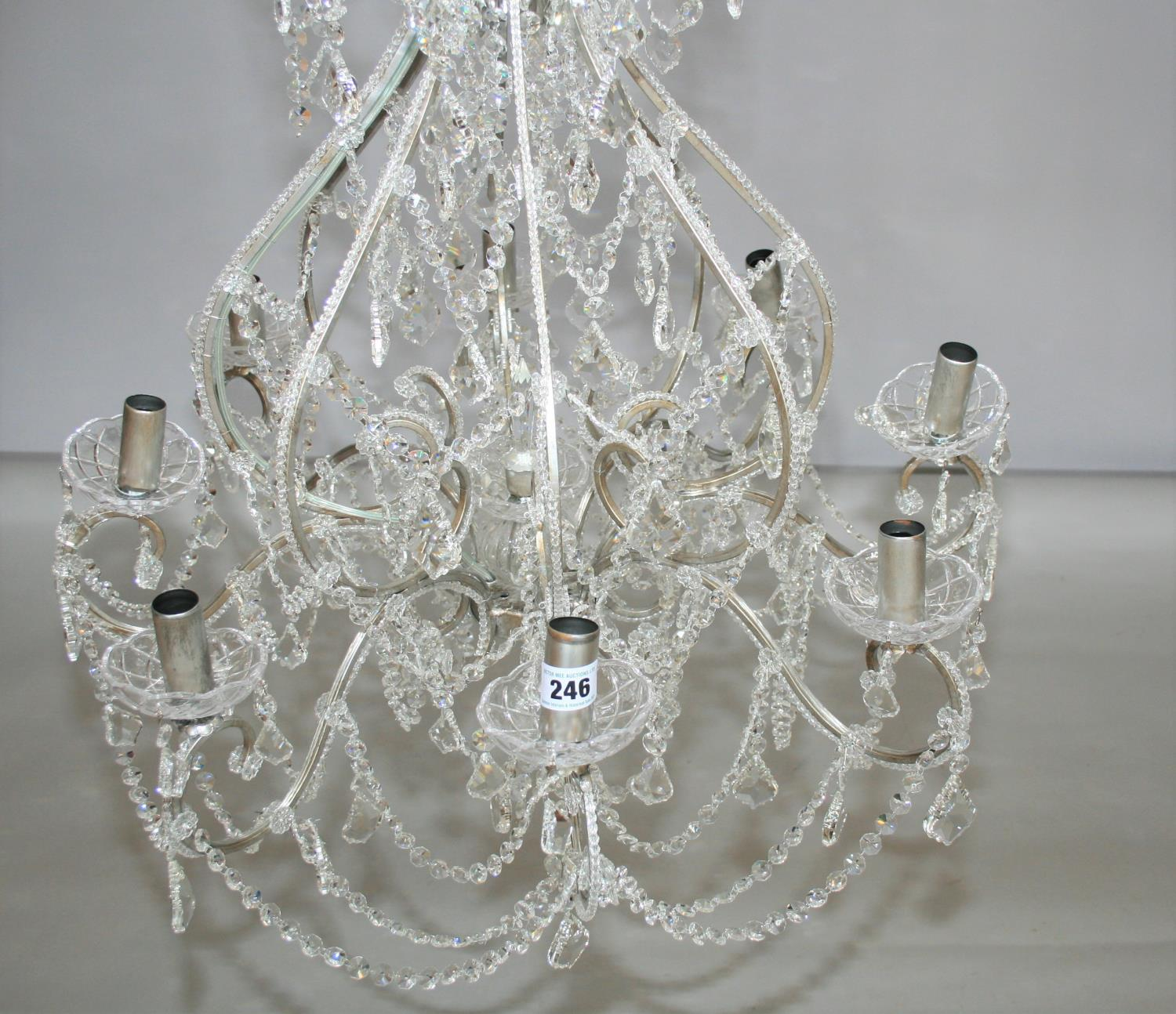 As new quality silver framed crystal 8 branch chandelier. 80W x 100H