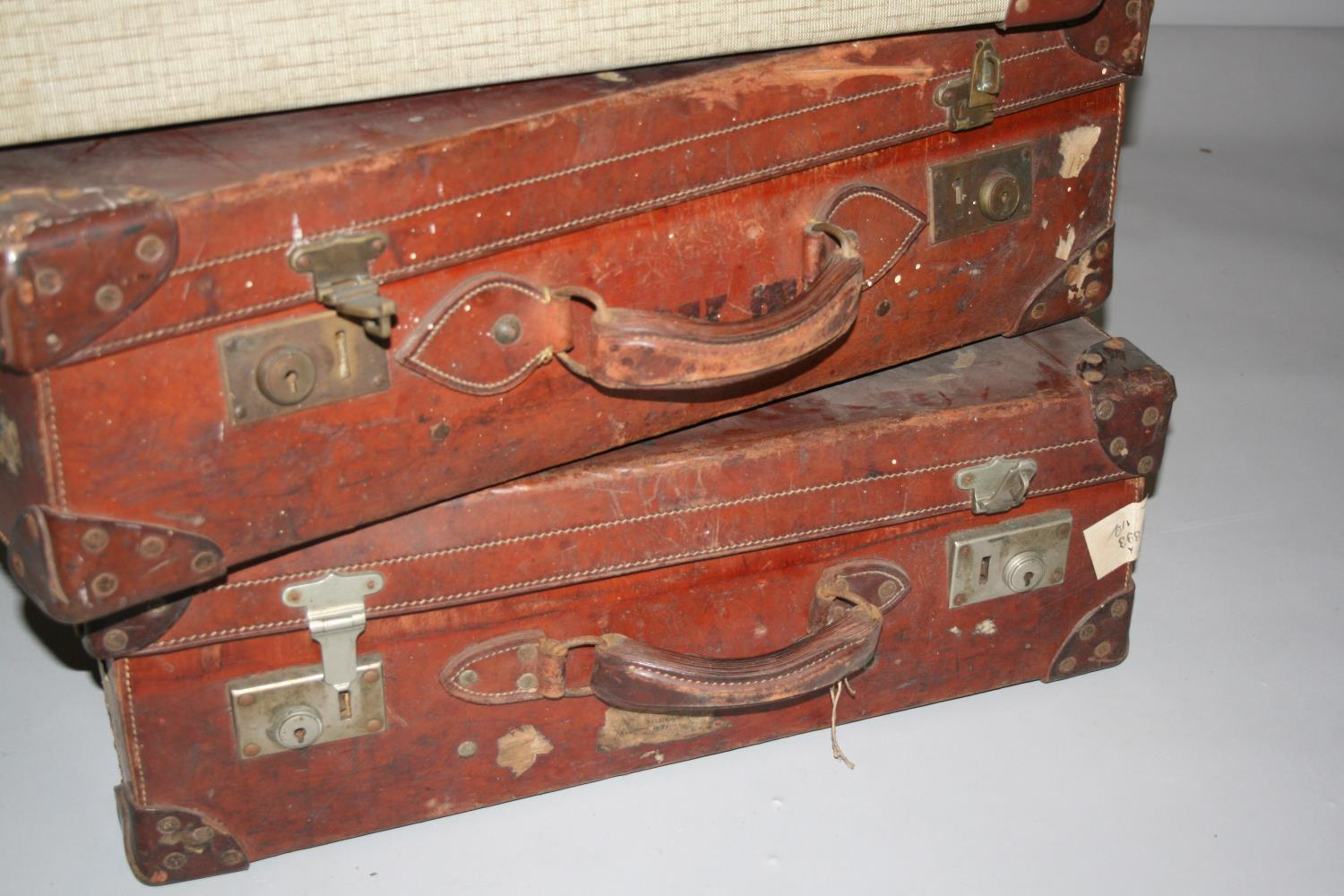 Four vintage leather suitcases, with compass, blade sharpener and wood plain. - Image 3 of 7