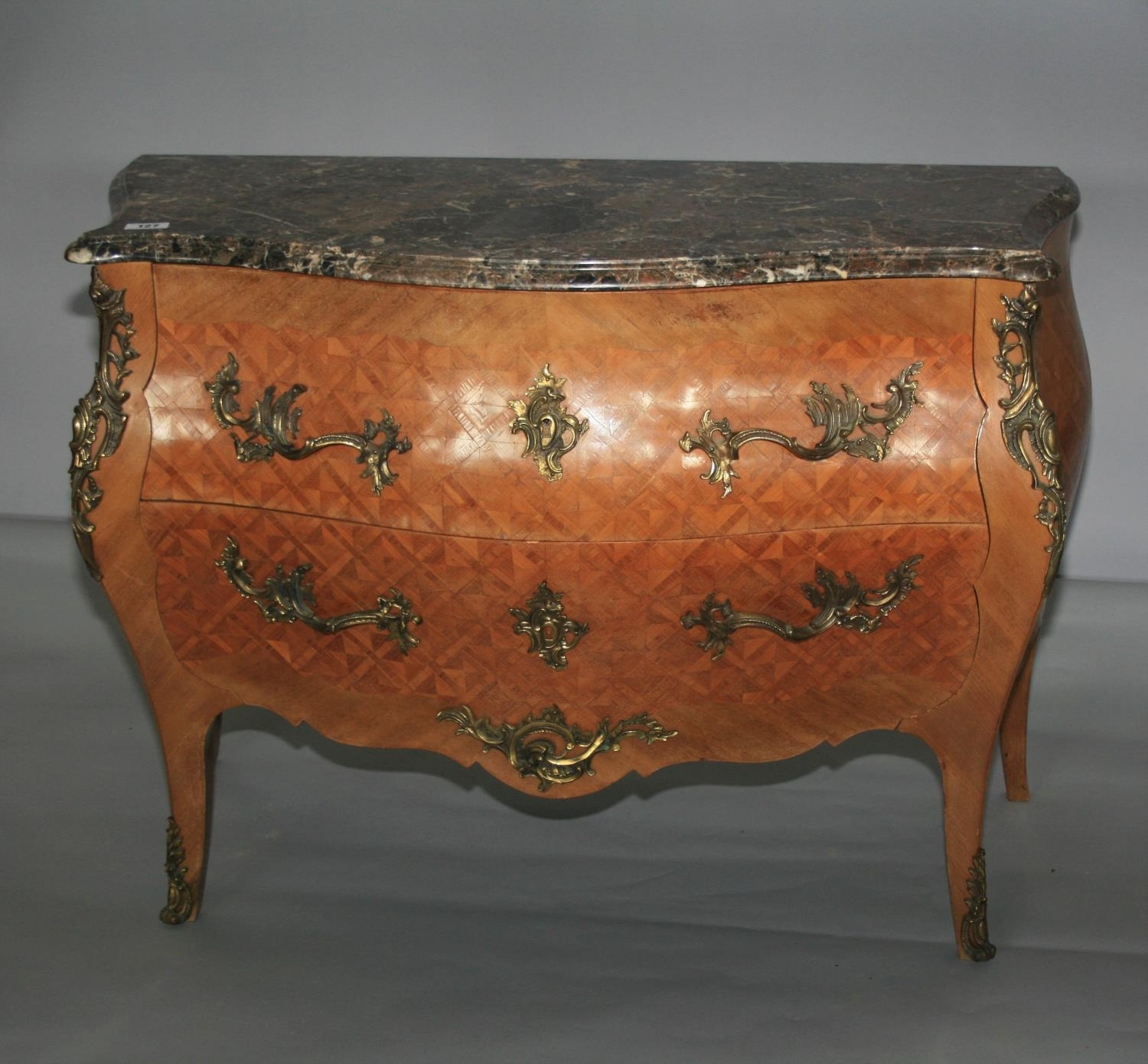 Fine quality antique serpentine commode with marble top above kingwood marquetry base with brass