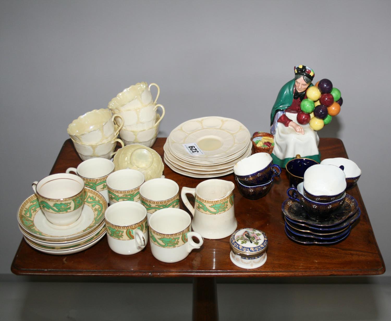 Part Belleek tea set, 2 other part tea sets, Royal Doulton balloon seller.