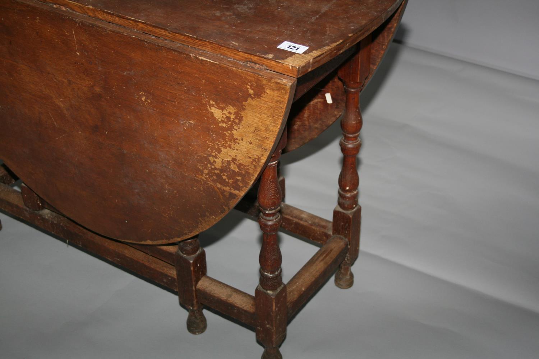 19th Century oak double drop leaf table. 107W x 76H x 43D - Image 2 of 3