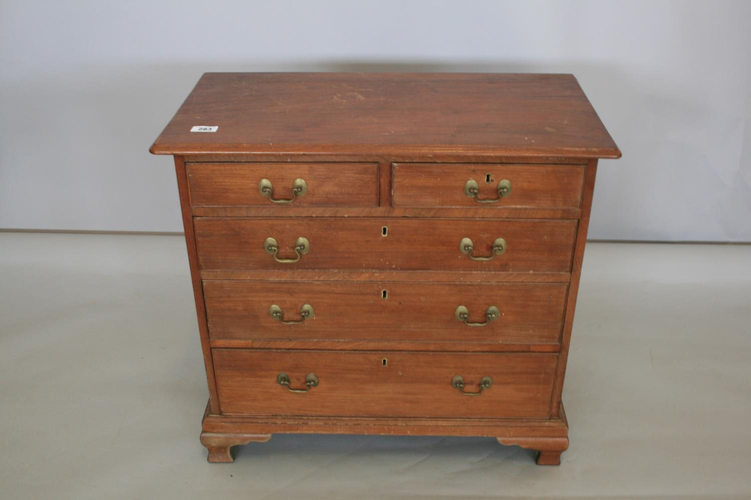 Neat proportioned Georgian chest drawers with two short and three long graduated drawers, standing