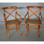 Pair of bentwood arm chairs with rattan seats. 50W x 90H x 60D