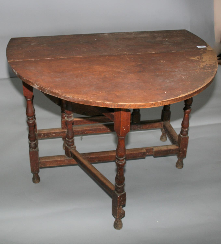 19th Century oak double drop leaf table. 107W x 76H x 43D - Image 3 of 3