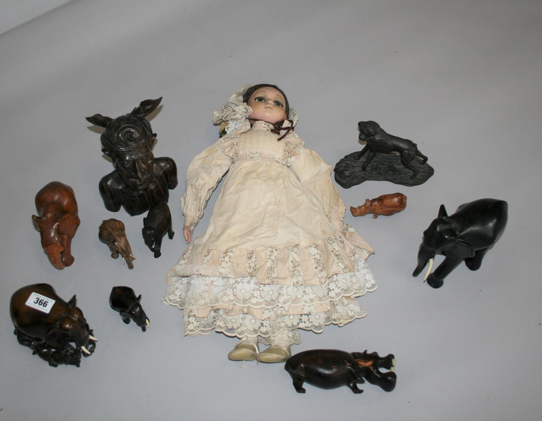 Vintage Doll and selection of hardwood elephants etc.