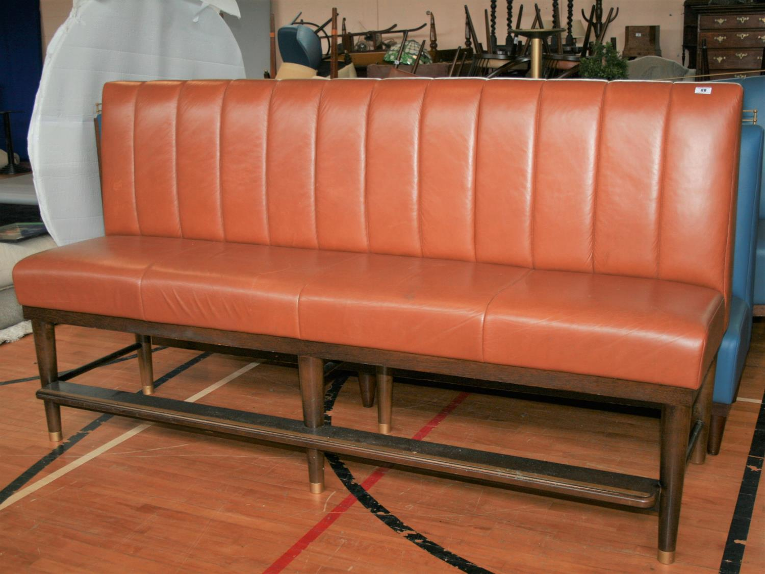 Fine quality fixed seating brown leather upholstered high seat with footrail and brass embellishment