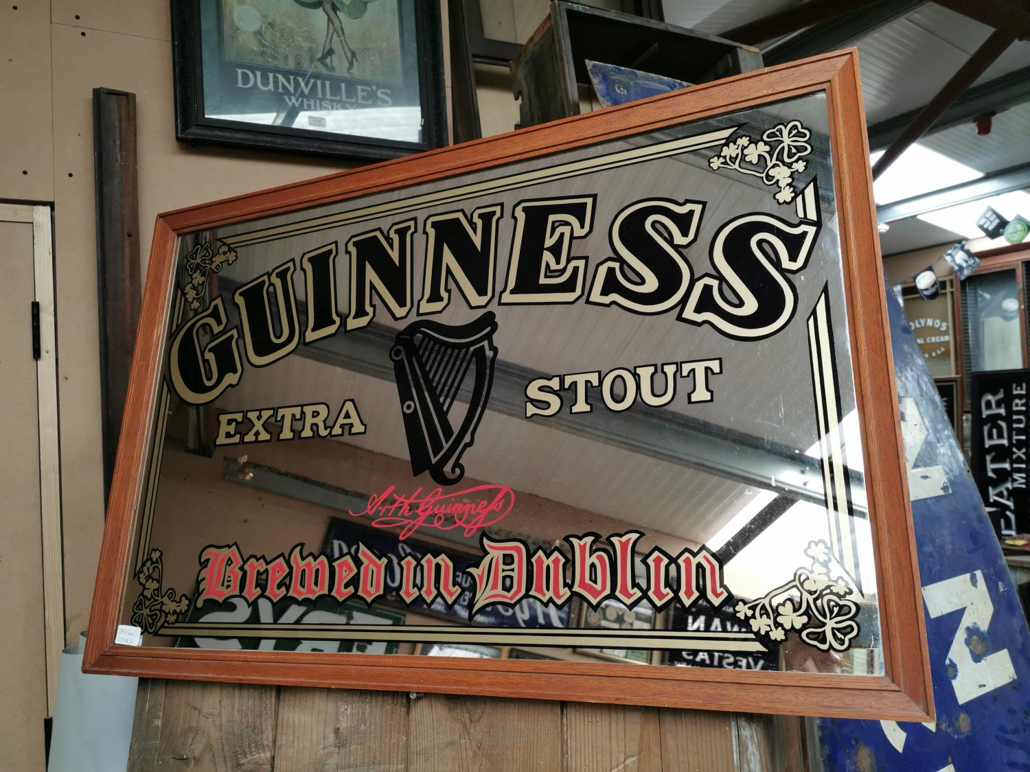 Guinness Extra Stout advertising mirror.