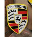 Porsche cast iron advertising sign.