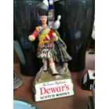 Dewar's Scotch Whiskey advertising figure.