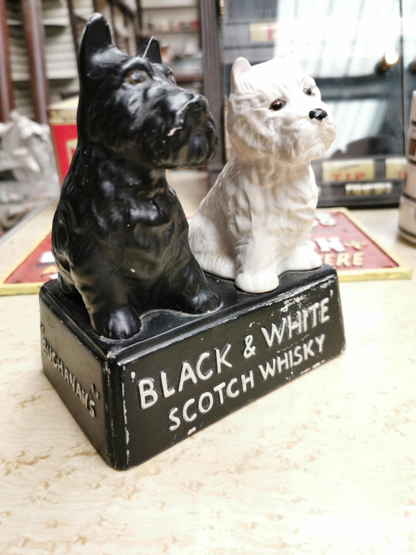 Black & White Scotch Whiskey advertising figure.