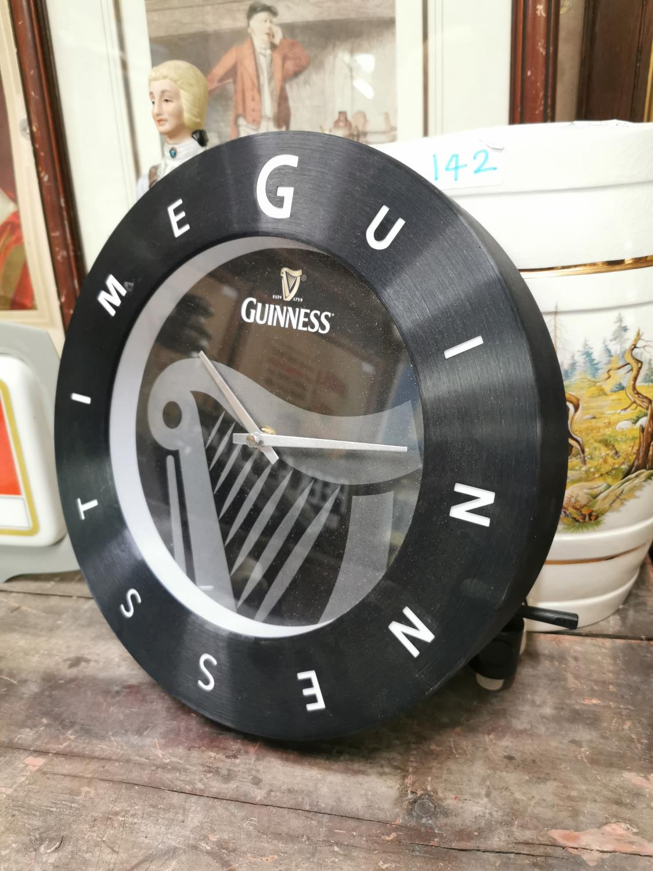 Guinness Time metal advertising clock.