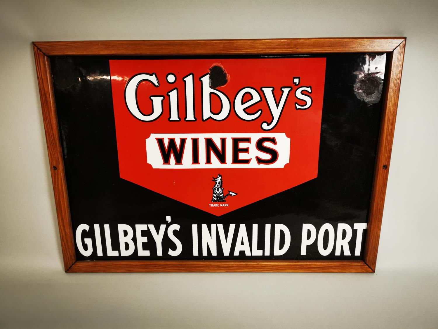 Gilbey's Wine and Port advertising sign.