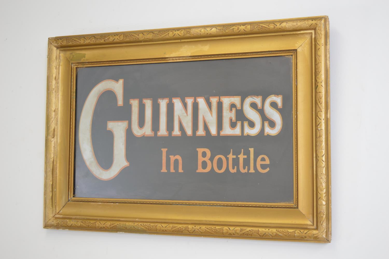 Guinness in bottle advertising print.