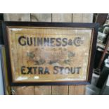 Guinness Extra Stout advertising showcard.